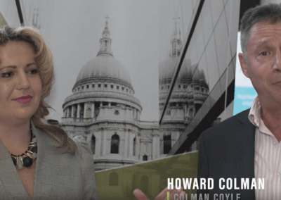 Howard Colman and Oksana Howard appear on video at IR Global conference over successful corporate acquisition for UK client